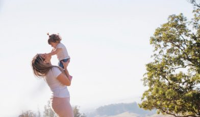 mom holding young child